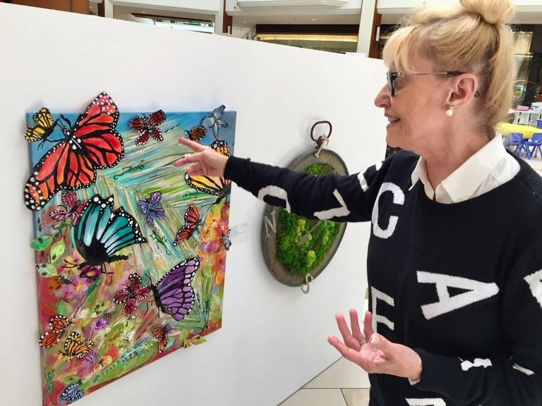 Artist Annie Chaskalson, whose piece 'Ants, butterflies, chameleons....Alphabet!' was made with the help of her 2½-year-old grandson, took part in the exhibition. CINDY ARBOLEDA CARBOLEDA@MIAMIHERALD.COM