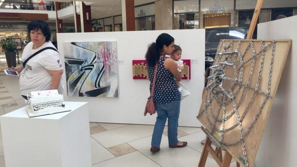 SmART Gallery Exhibition at the Aventura Mall in partnership with Just My Height Art Shows displayed works at 36 inches high, making them accessible for children to enjoy. CINDY ARBOLEDA CARBOLEDA@MIAMIHERALD.COM