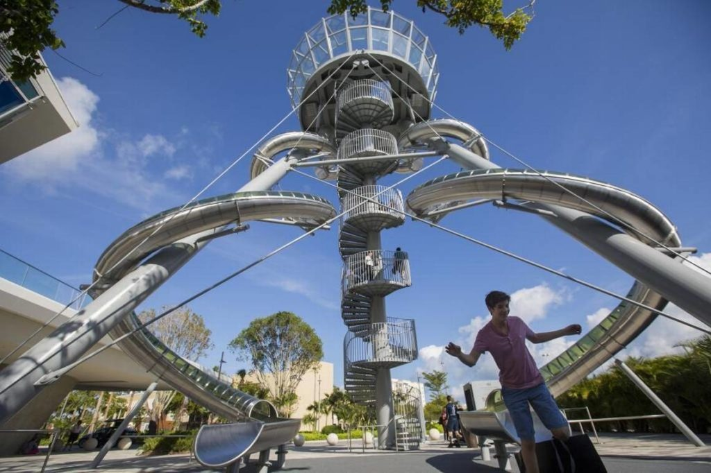 Neil Gilchrist, 15, reacts after going down a new 93-foot-tall slide at Aventura Mall on Monday, Dec. 18, 2017. Aventura Slide Tower, which is free for anyone to use, is part of a three-story wing expansion at the mall. The move added new restaurants, retail stores and an outdoor fountain.
