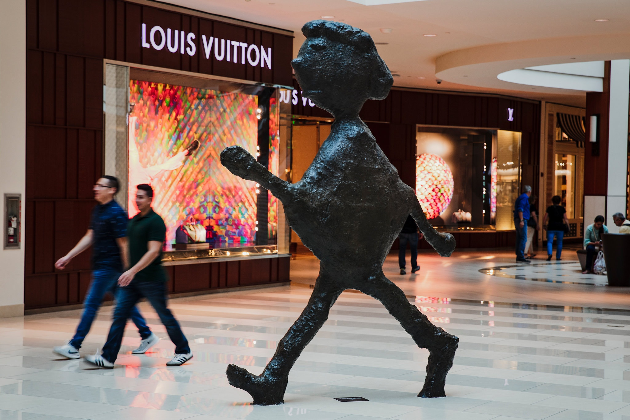 """Walking Figure,"" a sculpture by Donald Baechler at the mall.Credit...Scott McIntyre for The New York Times"