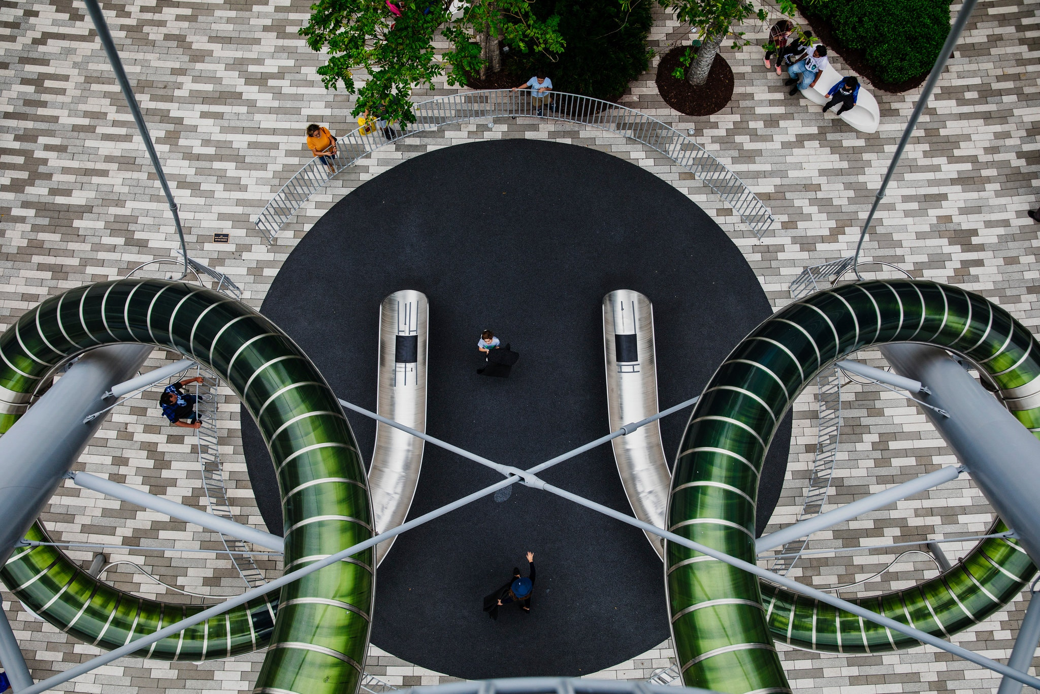 Aventura Mall in Florida began offering rides down a nine-story, double-chute tower slide in 2017.Credit...Scott McIntyre for The New York Times